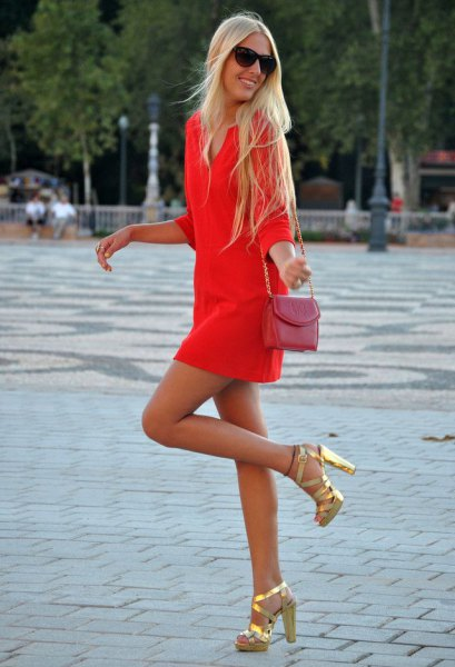 Orange long-sleeved mini dress with pink small shoulder bag