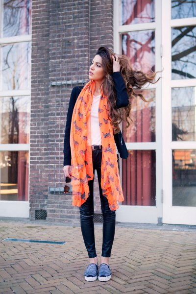 orange printed long chiffon scarf with black blazer and skinny jeans