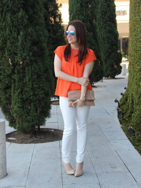 orange short-sleeved blouse with white slim fit jeans