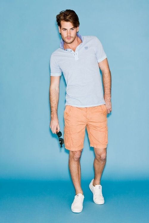 Men's Light Blue Polo, Orange Shorts, White Low Top Sneakers .