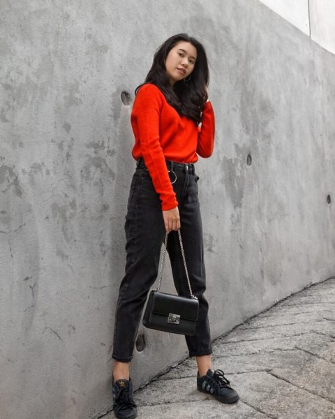 Orange sweater with black scarf and tied mom jeans