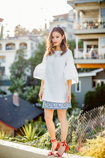 oversized skirt with bell sleeves and scalloped hem