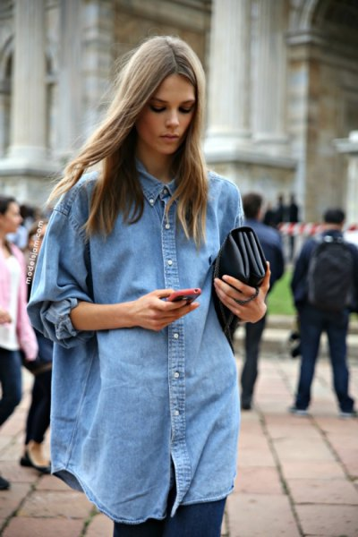 Oversized light blue chambray shirt with buttons and black leggings