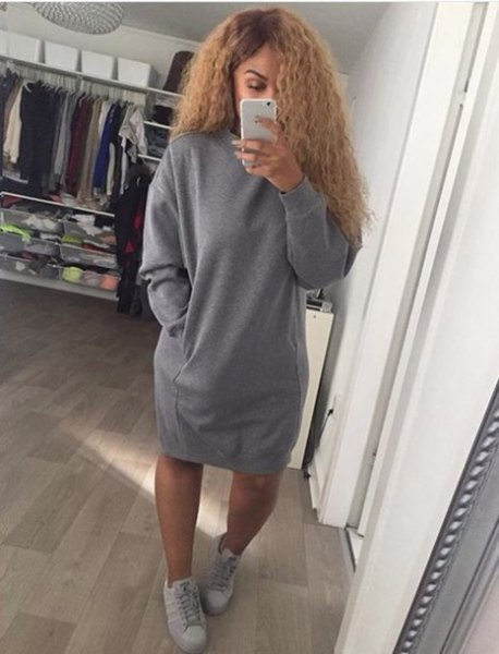 oversized sweater dress with gray sneakers