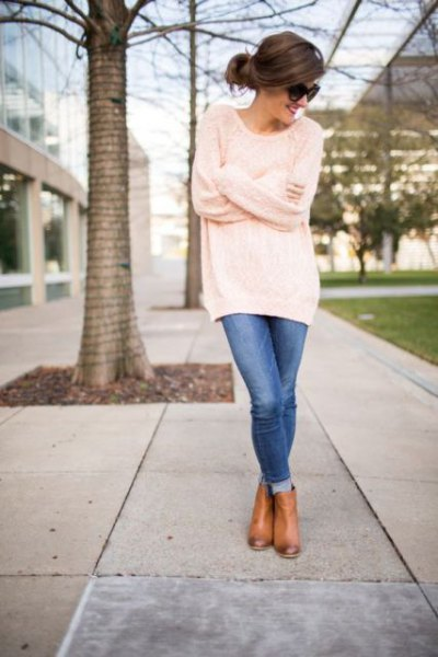 oversized tunic sweater with blue skinny jeans and leather boots