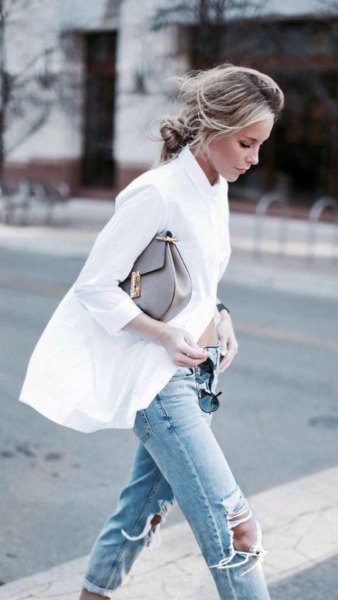 oversized white shirt with buttons and ripped light blue knee jeans