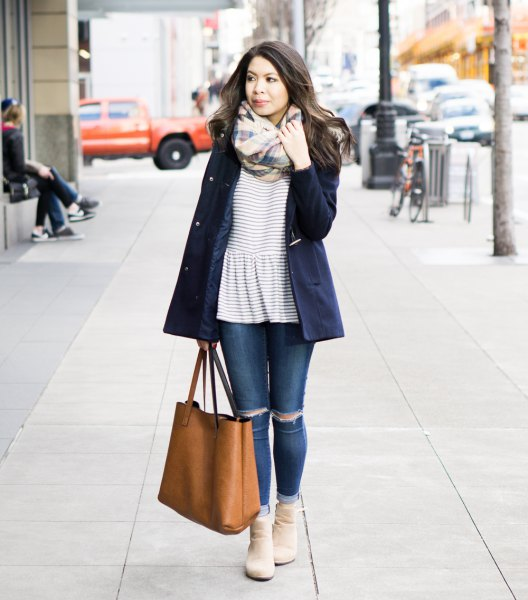 Oversized wool coat with black and white striped peplum top and jeans