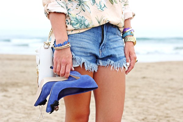 pale pink and white floral print shirt and blue denim shorts