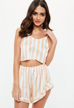 Light pink and white vertically striped flowing silk pajama shorts with a matching crop top