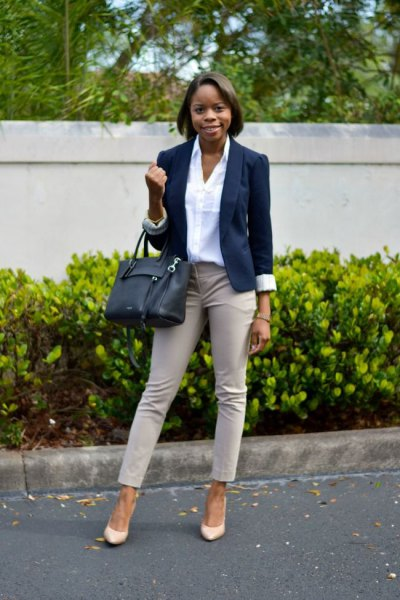 Light pink ankle pants with white shirt and dark blue blazer