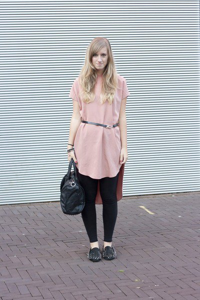 Light pink tunic top with belt, black leggings and spiked slippers
