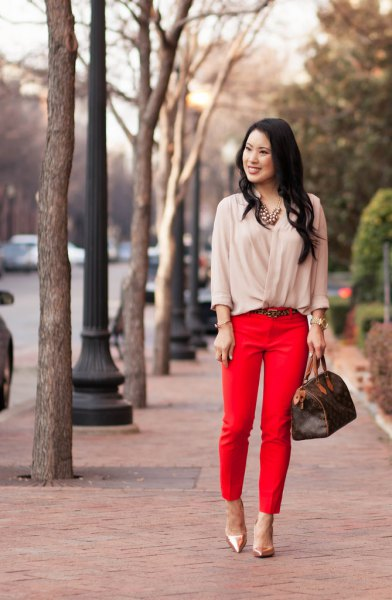 Light pink blouse with red, short cut trousers and rose gold heels