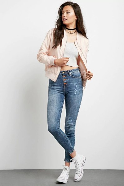 Light pink bomber jacket with a short white tank top