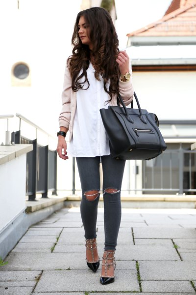 Light pink bomber jacket with a white shirt and black kitten heels