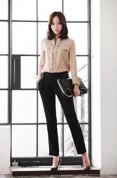 pale pink shirt with buttons and black, slim suit trousers