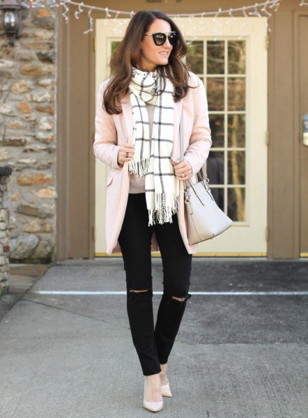 Light pink cardigan with a white and black checked fringed scarf
