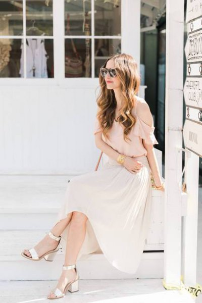 Light pink chiffon blouse with maxi white pleated skirt and golden open toe heels