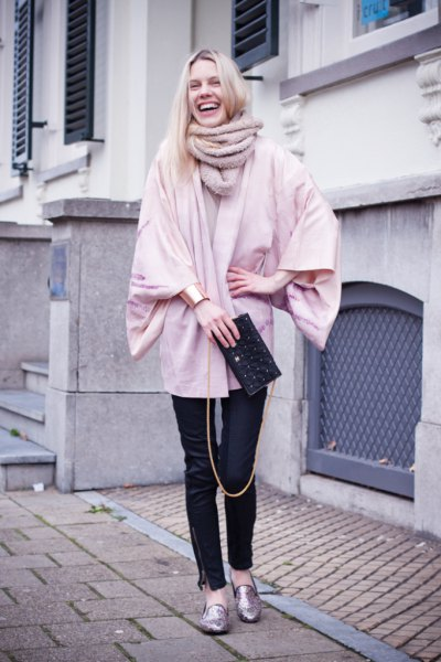 Light pink, chunky cardigan with black leather pants and gold metallic slippers