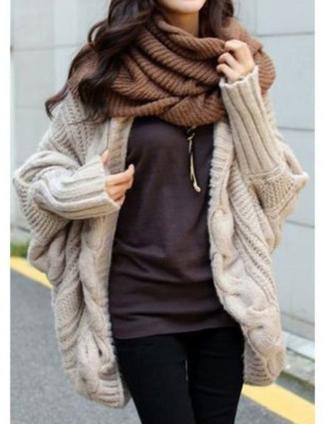 Light pink cardigan with a green scarf