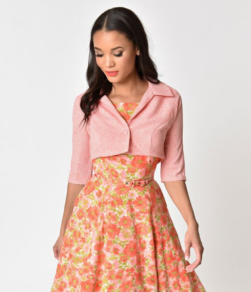 Light pink short-cut short-sleeved jacket with a red, floral printed midi dress
