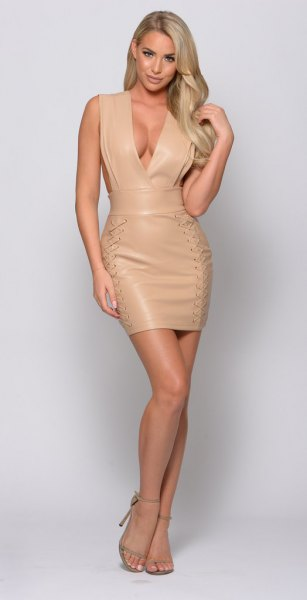 Light pink, figure-hugging mini dress made of synthetic leather with a deep V-neckline