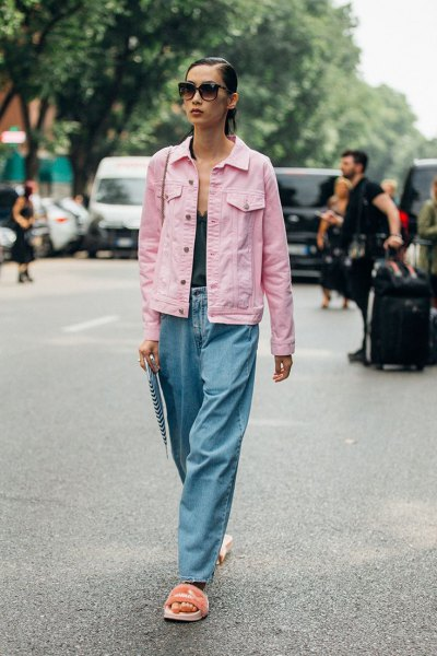 Light pink denim jacket with a black tank top with a deep V-neckline and wide-leg jeans