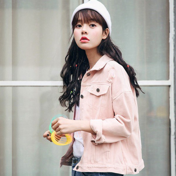 Light pink denim jacket with blue jeans and white knitted hat