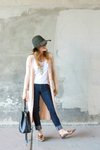 Light pink duster sweater with a gray floppy hat