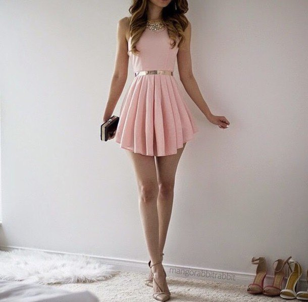 Light pink fit and flared, pleated mini dress with black and silver clutch handbag