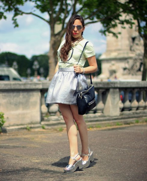 Light pink top with a silver skater skirt and platform sandals