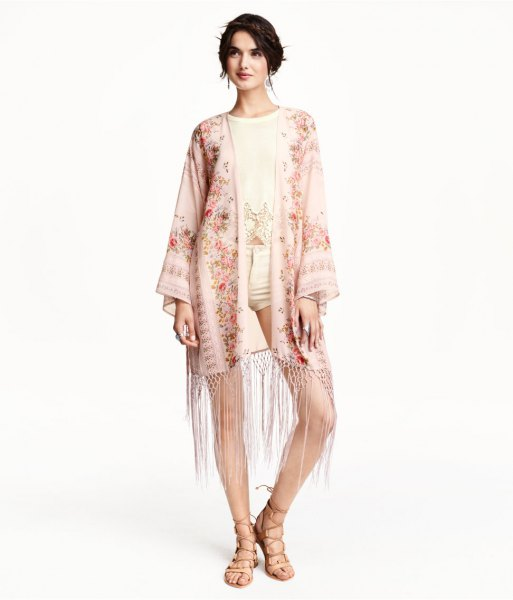 light pink kimono with yellow floral fringes, light yellow shorts