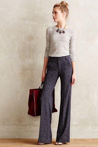 light pink figure-hugging sweater gray pants with wide legs