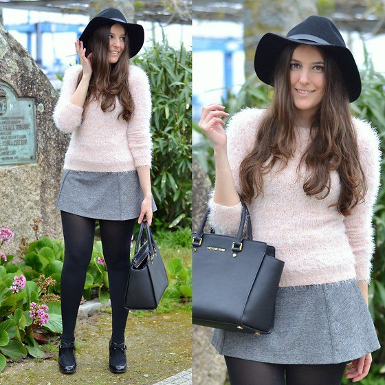 Light pink fuzzy sweater with a gray wool mini skirt