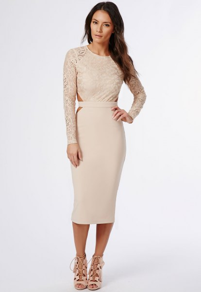 Light pink, figure-hugging midi dress with lace sleeves and open toe heels