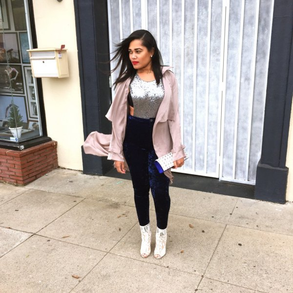 Light pink long blazer with a silver sequin tank top and dark blue leggings
