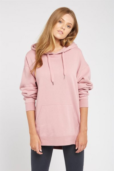Light pink hoodie with a long cowl neckline, black leggings and sneakers