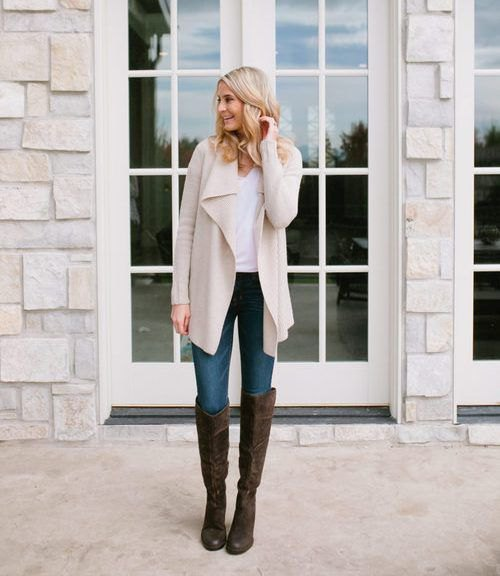 light pink long waterfall cardigan with white tank top and black knee-high boots