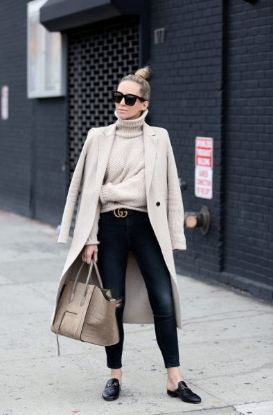 Light pink longline blazer with a turtleneck sweater and black slippers