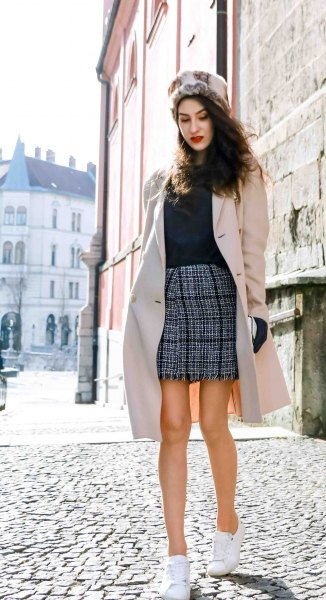 Light pink longline wool coat with a black and white checked mini skirt