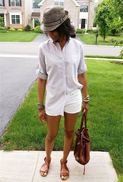 pale pink oversized shirt with buttons and gray checked hat