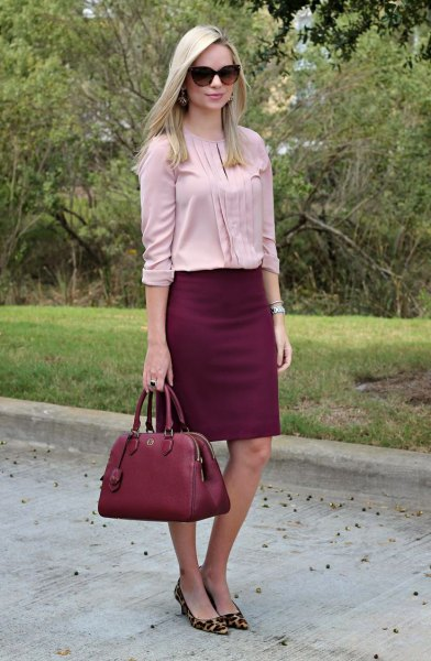 Light pink pleated blouse with a burgundy skirt and heels with a leopard print