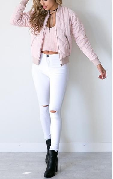 Light pink quilted bomber jacket with white high-waisted skinny jeans