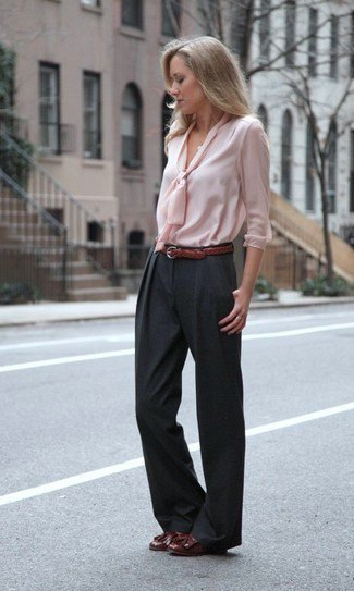 pale pink blouse in front with black wide-leg pants