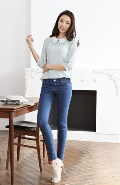 pale pink blouse with round collar and blue jeans