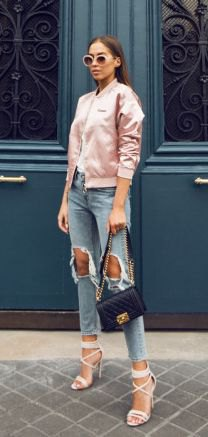 Light pink satin bomber jacket with heavily ripped, short cut jeans