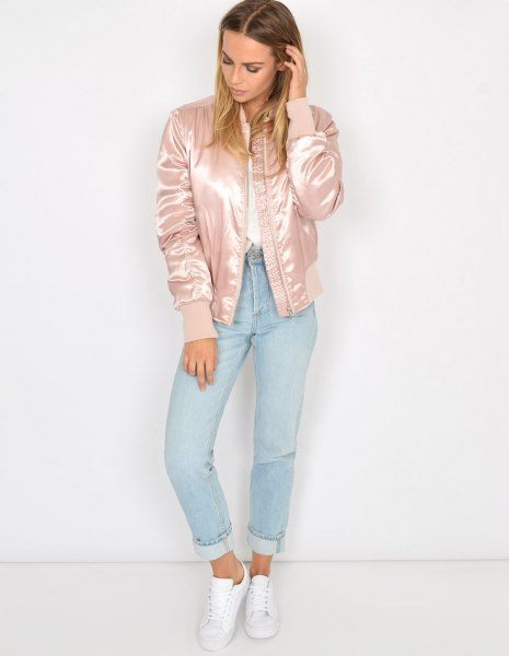 Light pink satin bomber jacket with white shirt and light blue jeans