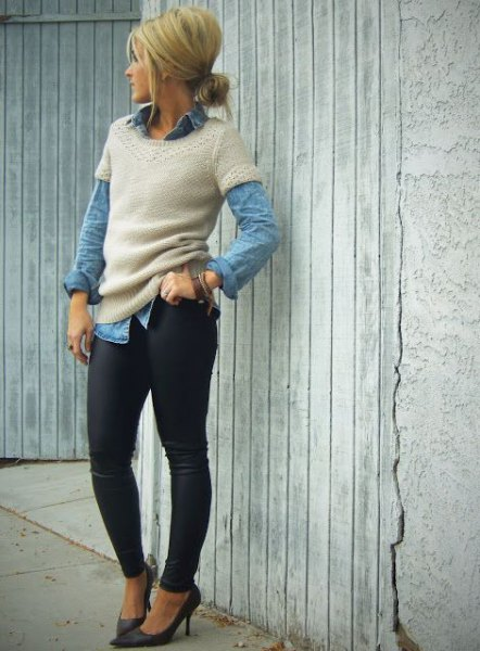 Light pink short-sleeved sweater over a blue chambray shirt with buttons