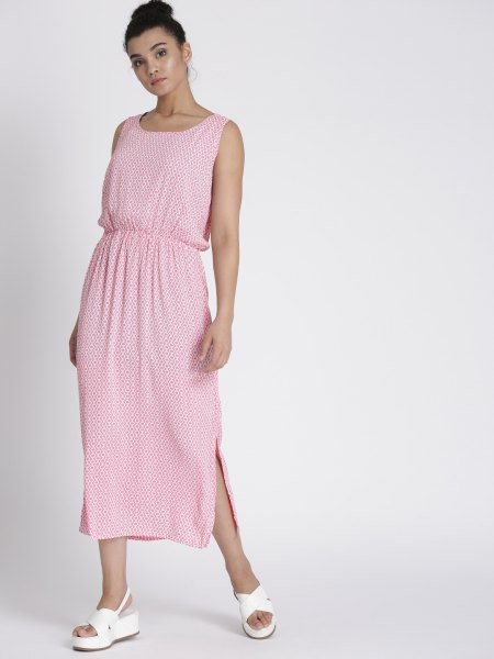 Pale pink sleeveless maxi dress with a gathered waist and white sandals