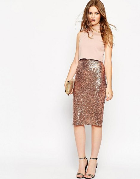 Light pink sleeveless top with a high-waisted midi skirt in rose gold