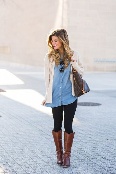 Light pink cardigan with a tunic denim shirt and gray leather boots